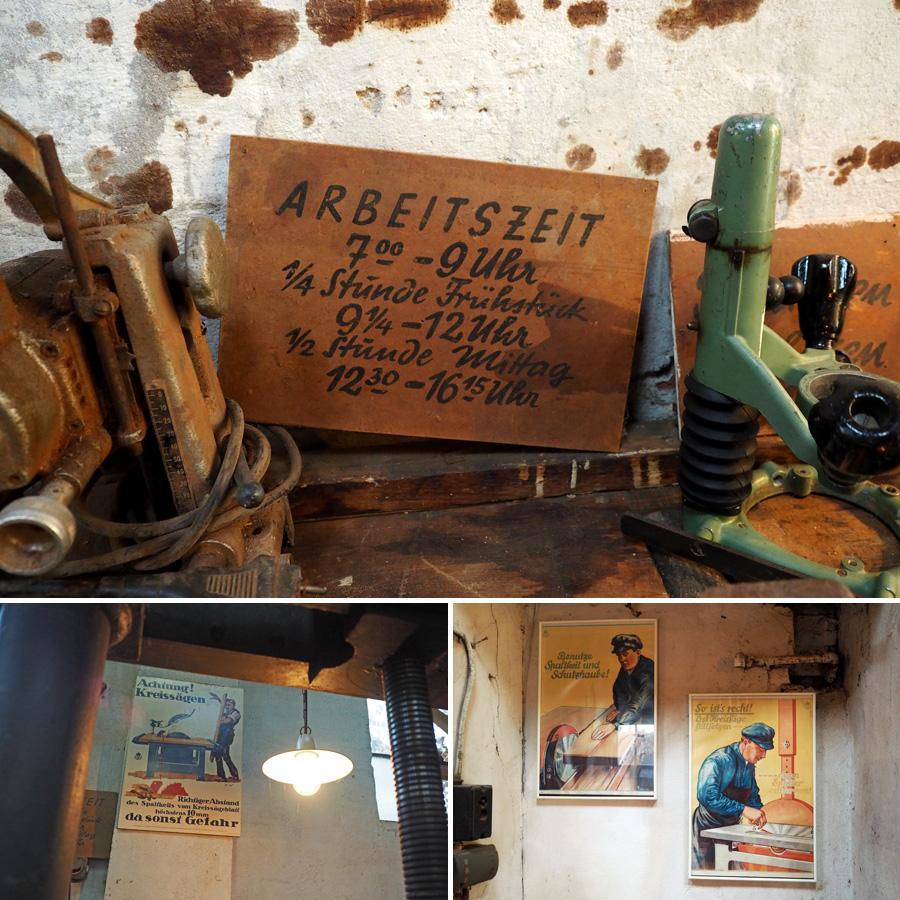 """Überall in der Werkstatt hängen Schilder für die Belegschaft: """"Achtung, Kreissäge!"""", """"Erst feststellen, dann säubern!"""" und natürlich die exakten Arbeitszeiten."""
